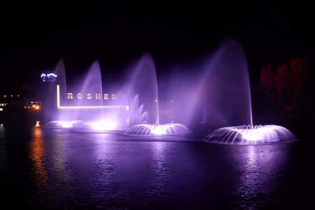 Public fountain Roshen in Vinnytsya, Ukraine - fountain built in the Southern Bug river near Island Camp (festival). Floating musical fountain with light and laser show is largest in Europe and one of the ten largest floating fountains in the world