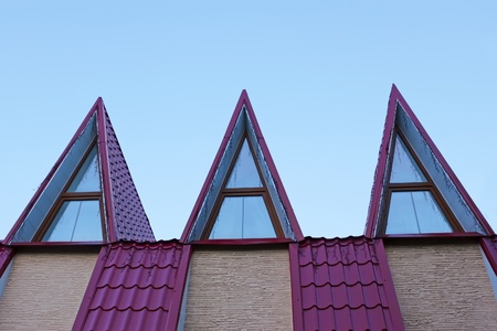 Detail of the roof covered with metal tile in evening light photo