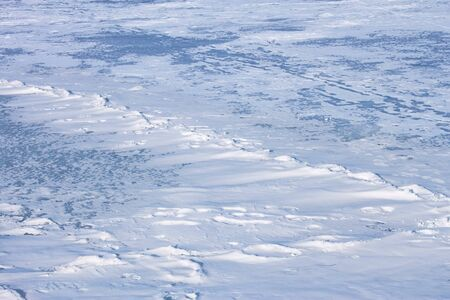zoned: Snow hummocks on the surface of frozen reservoir Stock Photo
