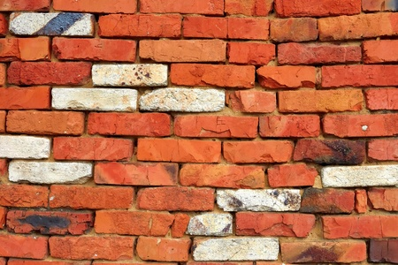 silica: Fragment of a wall of red brick with a few bricks of white refractory silica brick