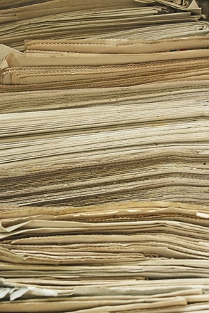 utilization: Stack of the old yellowed newspapers close up Stock Photo