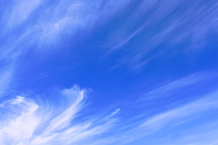 elongated: Stratospheric elongated clouds against blue sky background