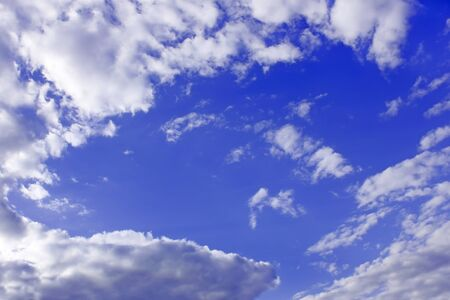 Heaven. Cloudscape of light white clouds around blue sky, warm spring day photo