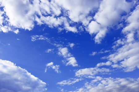 Heaven. Cloudscape of light white clouds around blue sky photo