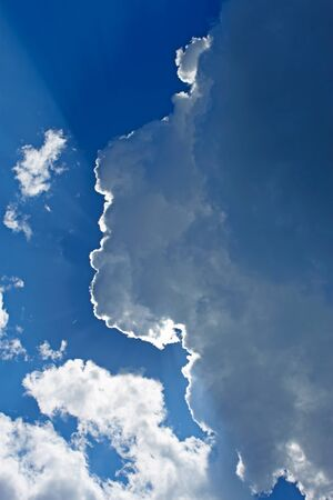 Heaven. Sun rays penetrate through the thick clouds and forming halo effect Stock Photo - 13637986