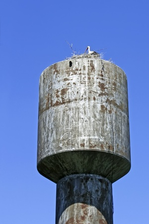 Stork nest on top of the old water tower Stock Photo - 14168721