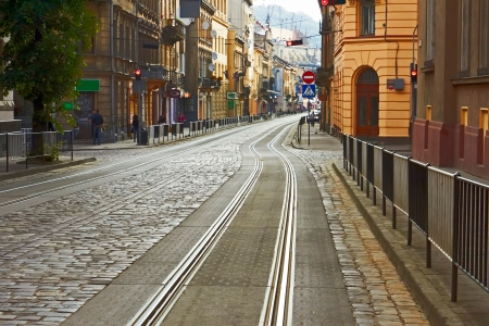 Old cobbled street with tram tracks in the downtown of Lviv, Ukraine photo