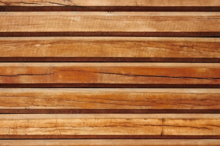 Horizontal parallel old wooden logs. Part of traditional wooden house walls photo
