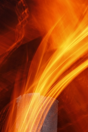 Abstract flame texture with old metal chimney at night