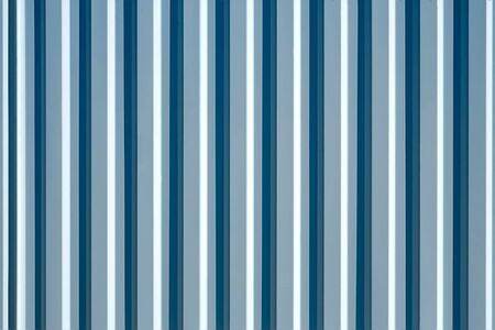 ribbed: Metal ribbed painted fence surface with shadows as texture