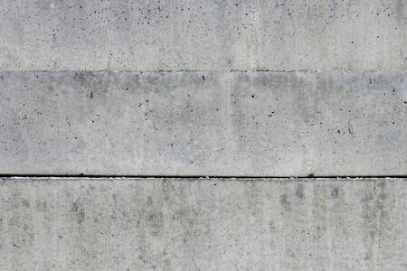 composed: Three large massive concrete blocks composed horizontally Stock Photo