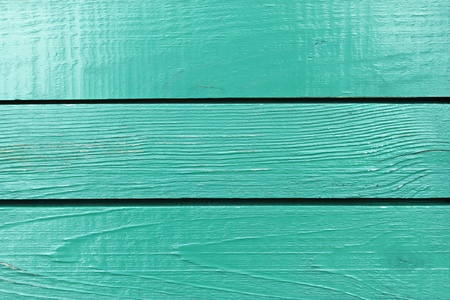 Fragment of wooden fence painted in bright aquamarine Stock Photo - 15220746
