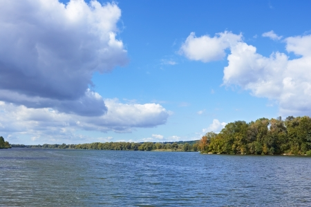 Beautiful cloudy scenery over the river of early autumn photo