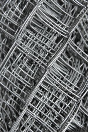 Steel mesh with water drops composed in multiple layers close-up photo