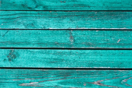 turquoise: Fragment the shield of parallel horizontal old wooden boards painted in green