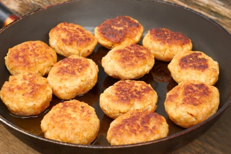Group of fried meat cutlets on a pan close up photo