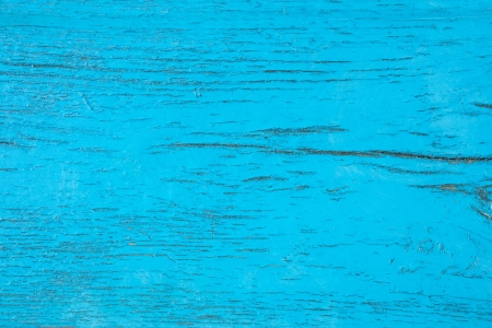 Detail of old wooden boards painted in blue with several layers of shelled paint photo