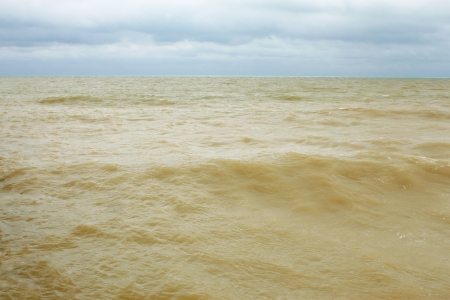 Coastal sea water after the storm contaminated dredged from the seabed sand photo