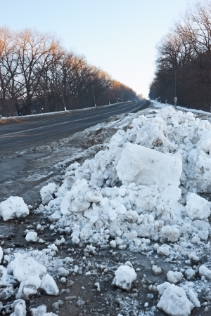 hummock: Big snow hummock on the roadside during sunset in winter evening Stock Photo