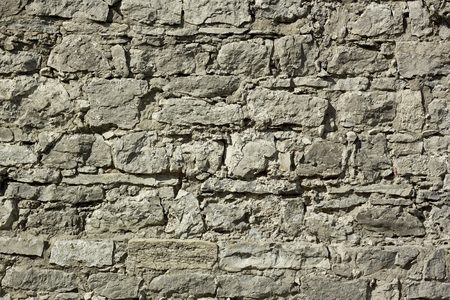 bumpy: Fragment of a wall relief ancient fortification with large boulders in sunny day