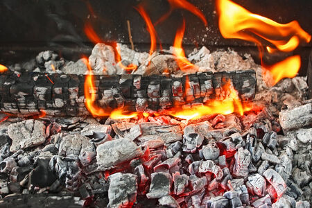 Fire from burning firewood with ashes and flames photo