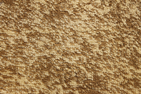 fleecy: Textured details of carpet with fleecy synthetic fabric of beige color