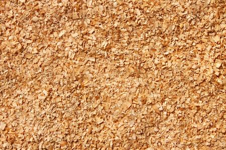 yellowish: Fine yellowish sawdust as a texture, macro photo