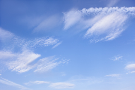 Beautiful cloudscape with different types of clouds on the background of blue sky