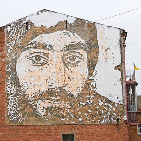 dignity: KYIV, UKRAINE - MARCH 13, 2016: Graffiti in honor of Serhii Nihoian, ethnic Armenian who died during the Revolution of Dignity in Kyiv on January 22, 2014. Graffiti performed by Portuguese artists group led by Alexandre Farto (VHILS), Mykhaylivska Street, Editorial