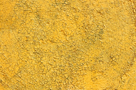 multilayer: Multilayer painted shelled and cracked yellow surface outdoors as the texture