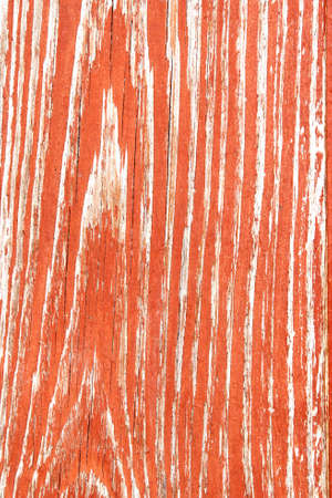 shelled: Old wooden desk painted in red with weathered and shelled surface and with annual rings Stock Photo
