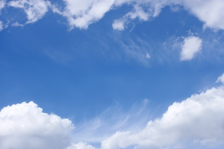 Blue sky and bright white clouds as a background
