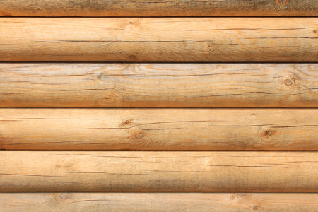 Horizontal parallel large new wooden logs in sunlight, close-up and detailed Stock Photo