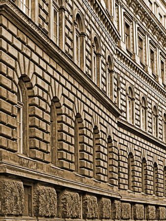 Ancient building wall with windows in sepia Stock Photo