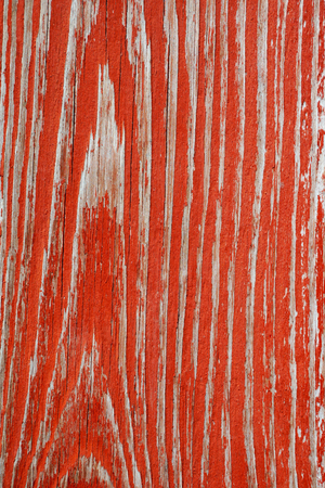 Detail of old red painting shelled wooden desk