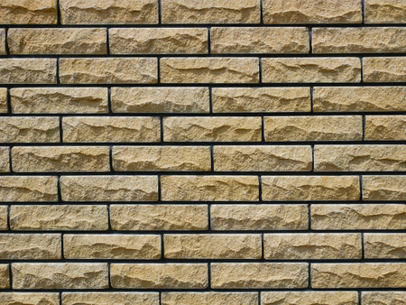 Brick stone wall background in warm hues Stock Photo