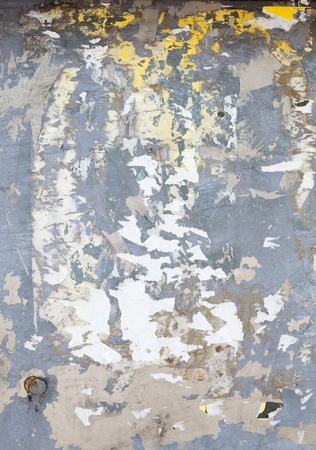 torn metal: Metal Surface Covered in Torn Poster Bill Scraps Stock Photo