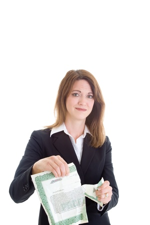 Caucasian businesswoman tearing stock certificate