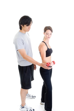 Asian man and Caucasian woman in work out clothing isolated on white. Stock Photo - 8932003