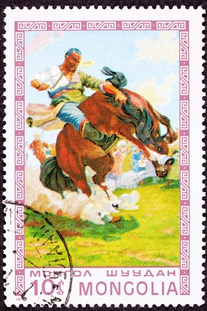 commemorative: Canceled Mongolian Postage Stamp Man Breaking Wild Horse Bucking Bronco