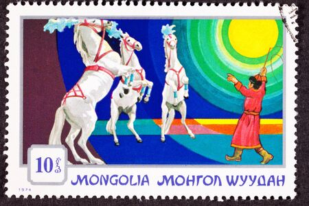 canceled: Canceled Mongolian Postage Stamp Standing Rearing Horses Performing, Circus Trainer Stock Photo