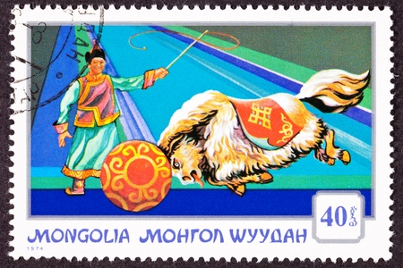 canceled: Canceled Mongolian Postage Stamp Performing Yak Pushing Ball, Circus Trainer, part of a series on Mongolian circuses