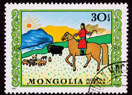herder: Canceled Mongolian Postage Stamp Horseback Woman Herding Sheep Yak Steppe, from a child art series