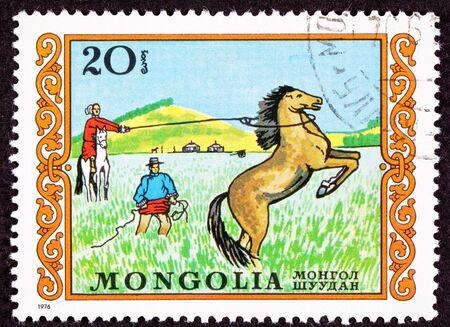 canceled: Canceled Mongolian Postage Stamp Men Capturing Lassoing Wild Horse Grassland