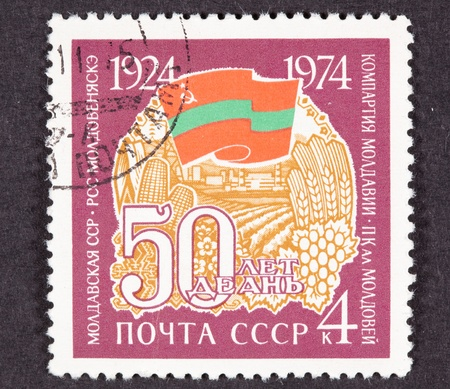plow: Russian Stamp Celebrating 60 Years of Agriculture, Moldavian SSR which at the time was part of the USSR. Moldavian Flag shown.