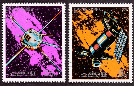 canceled: Canceled North Korean Postage Stamp Space Themed Satellites Milky Way.  Two images stitched together.  Orange stamp is space station.