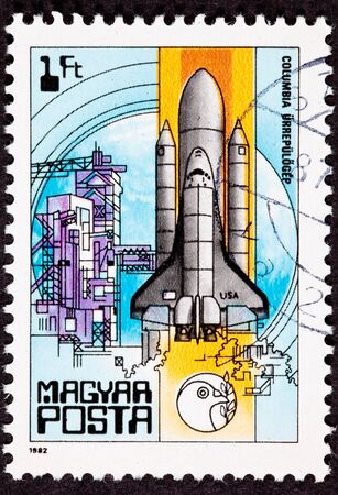 Canceled Hungarian Magyar Postage Stamp showing the Space Shuttle Columbia launching from the tower. photo