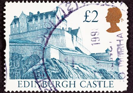 postage stamp: Cancelled Postage Stamp Edinburgh Castle, Scotland Hilltop Fortress Wall Stock Photo