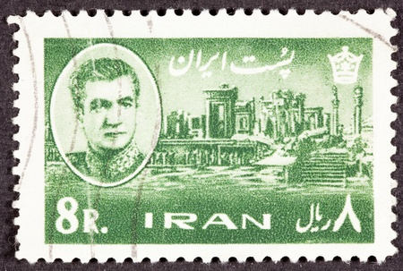 continued: Iranian Postage Stamp Shah, and the palace started by Persian Emperor Darius and continued by his son Xerxes, in Persepolis. Stock Photo