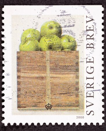 canceled: Canceled Postage Stamp showing a peck of Granny Smith apples in a wooden box.  Painting by Philip Von Schantz.